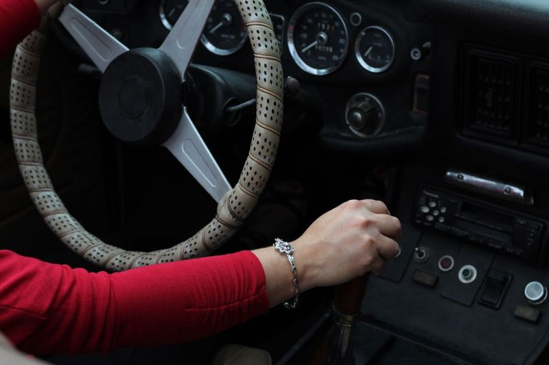Red Driving Convertible Steering Wheel Vehicle Interior Human Body Part Hand Human Hand Mode Of Transportation One Person Indoors  Real People Transportation Control Panel Lifestyles Motor Vehicle Dashboard It's About The Journey