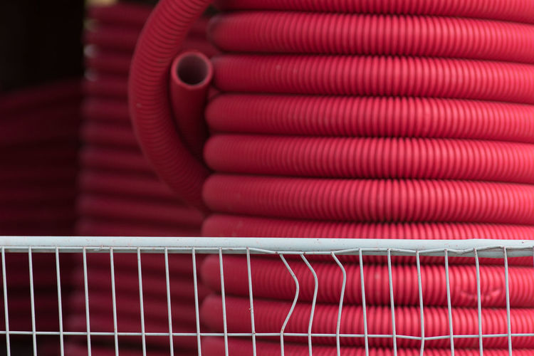 Close-up of red pipes for sale