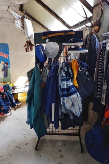 Male closet with many fashionable clothes on hanger,jeans ,cap ,shoe and bag with bedroom for background Teenage Street Sneaker Bag Cap Modern Design Clothing Clothes Wardrobe Fashion Design Interior Room Decor Room Bedroom Fashion Male Hanging Clothing Clothing Store Retail  Coathanger Store Variation