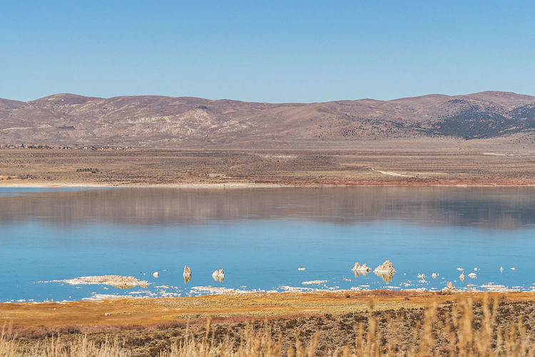 Mono lake, california autumn on sunny day with blue sky and tufa formations