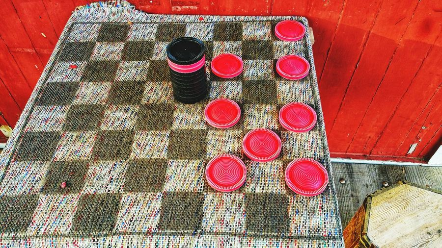 Checkers anyone? Let's play! Checkered Checkers Game Cloth Cloth Checker Board Red Black Chips Challenge Thinking Strategy Leisure Healthy Lifestyle Fun Enjoyment Round Square Alternate Zen Strategic Red Pattern High Angle View Close-up Cloth Colorful Textile Woolen Thread Weaving