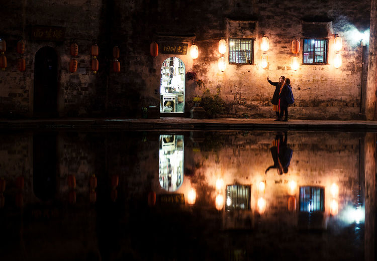 Selfie Ancient Hongcun, China Lights Pond Tourist Travel Adult Architecture Chinese Dark Illuminated Mystery Night Reflection Selfie Silhouette Standing Street Traditional Village Water