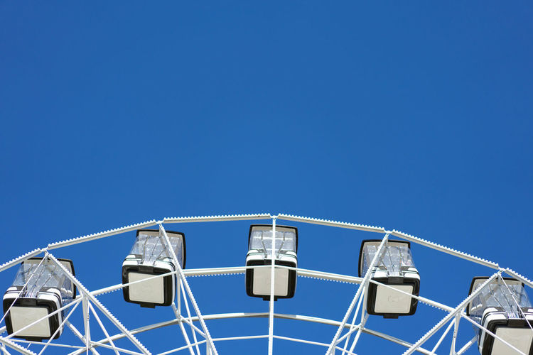 Amusement Park Architecture Blue Building Building Exterior Built Structure Clear Sky Copy Space Day High Section Low Angle View Metal Mode Of Transportation Nature No People Outdoors Sky Sunlight Transportation White Color