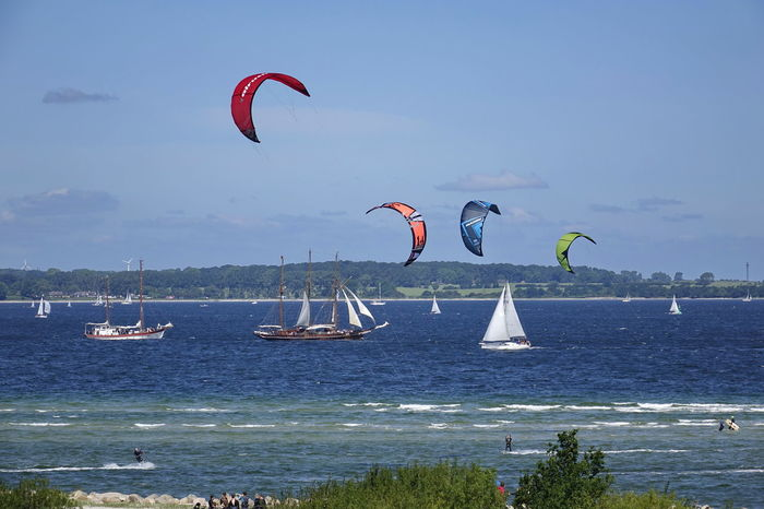 Beauty In Nature Day Extreme Sports Flying Kieler Woche Kitesurfing Leisure Activity Lifestyles Men Mid-air Nature One Person Outdoors Parachute Paragliding People Real People Sailing Ship Scenics Sea Sky Tree Water Yacht Sommergefühle