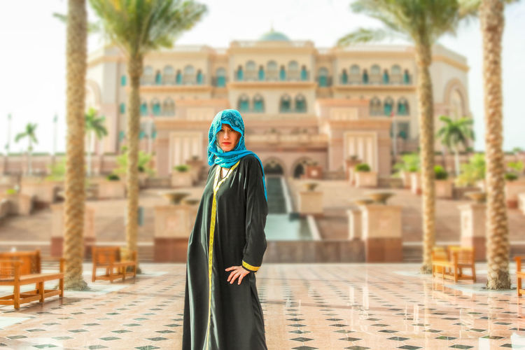 Woman with typical Arab clothes. Luxury vacations and tourism concept. Defocused background at Abu Dhabi, the capital of United Arab Emirates. Holidays, lifestyle and expensive concept. Abu Dhabi UAE United Arab Emirates Woman Abu Dhabi UAE Arab Arabic Architecture Building Exterior Built Structure Day Emirates Focus On Foreground One Person Outdoors Palace Real People Sky Standing Woman Portrait Young Adult Young Women