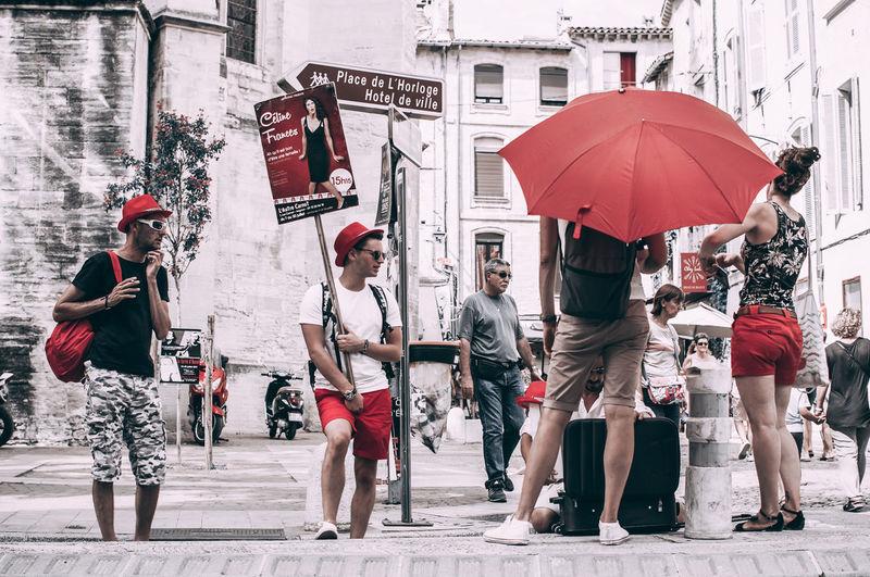 People walking on wet street in city