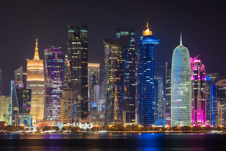 Doha, Qatar Building Exterior Illuminated Night Architecture Built Structure Office Building Exterior Building City Skyscraper Water Waterfront Landscape Cityscape Tall - High Modern Travel Destinations Urban Skyline Office Residential District No People Financial District  Doha Qatar Middle East Travel