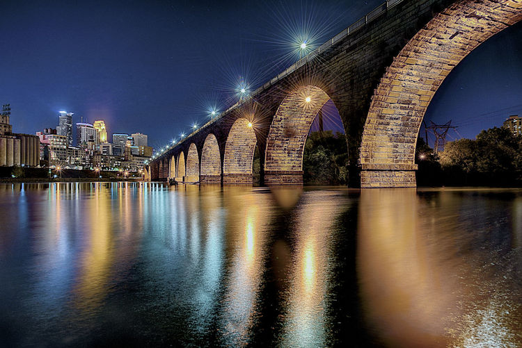Stone Arch Bridge Architecture Reflection Night River Water City Sky Illuminated Cityscape Mississippi River Minneapolis Minnesota No People Stone Arch Bridge Built Structure Bridge - Man Made Structure Connection Long Exposure Transportation Waterfront Travel Destinations Outdoors Building Exterior