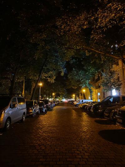 Cars on illuminated street at night