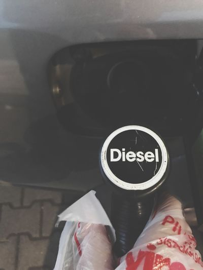 Re fueling diesel Fuel And Power Generation Diesel Human Body Part Real People Mode Of Transportation Vehicle Interior Human Hand Body Part One Person Unrecognizable Person Motor Vehicle Car Car Interior Text Human Leg Finger Personal Perspective Lifestyles Hand Land Vehicle Communication Transportation