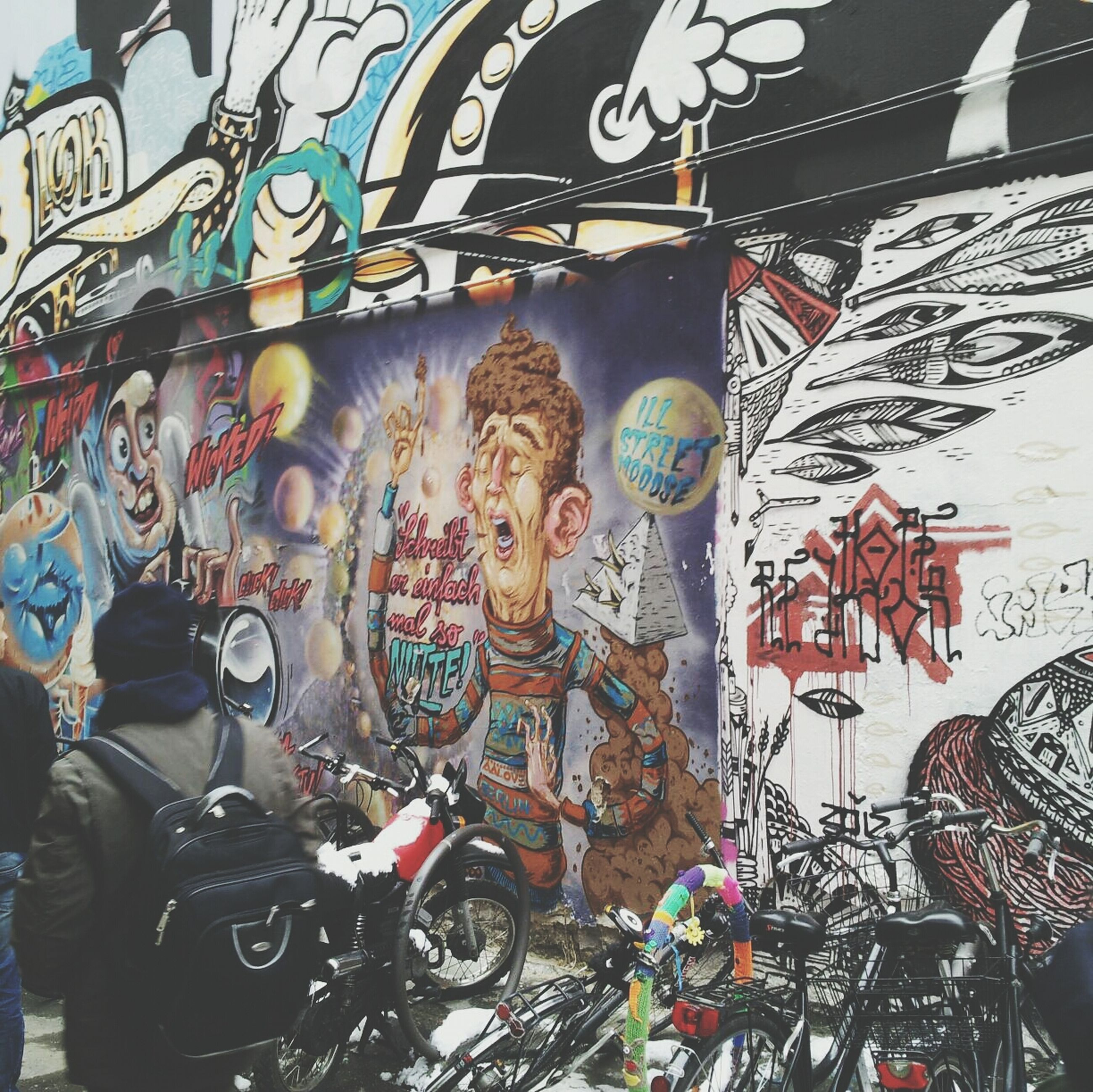 art and craft, art, creativity, graffiti, human representation, bicycle, built structure, architecture, wall - building feature, land vehicle, sculpture, multi colored, transportation, building exterior, animal representation, day, statue, street art