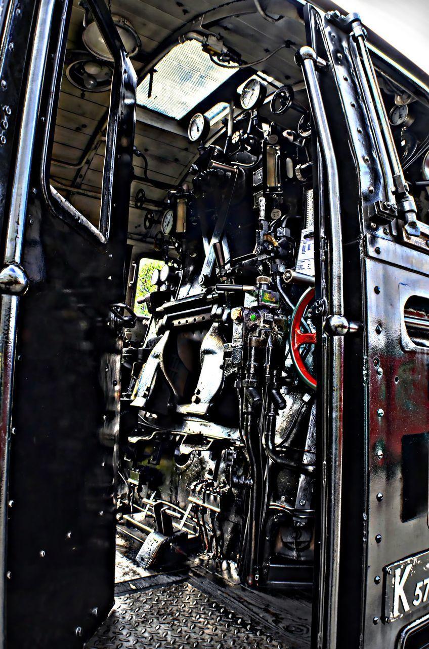 CLOSE-UP OF MACHINE PART IN GARAGE