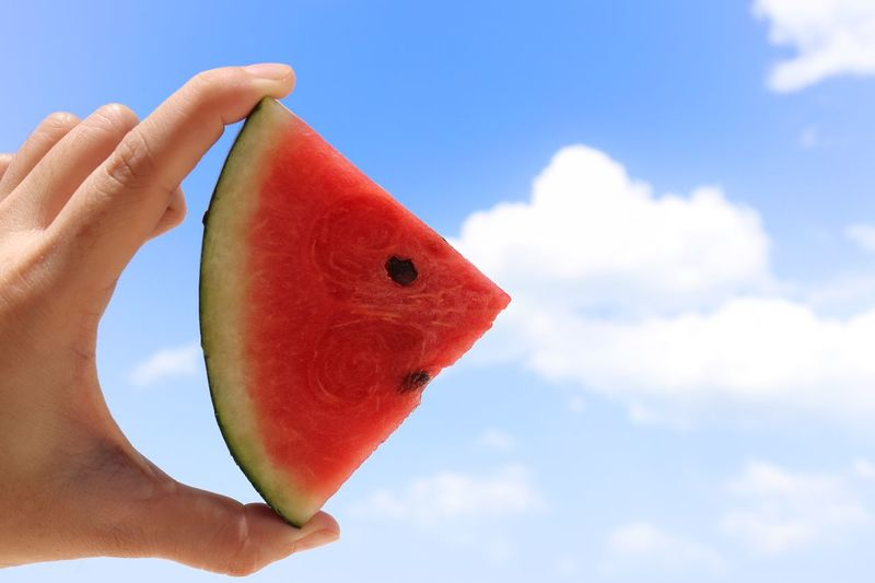 show red watermelon with blue sky background and have space for text. Bright Food And Drink Quotes Relaxing Textured  Day Drink Food Fresh Freshness Fruit Healthy Jucie Juicy Lifestyles Melon Party Sky SLICE Smile Space Summer Tropical Water Watermelon