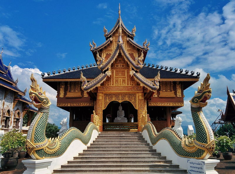 Asian wooden temple with two green naga and blue sky Religious Architecture Religion Buddha Naga Worship Architecture Asian  Travel Destination Design Snake Myanmar Thailand Culture Art Treasure Clean Peaceful Meditation Blue Sky Landscape Beautiful Architecture Sky Religion Cloud - Sky No People Statue Outdoors Day EyeEmNewHere Shades Of Winter