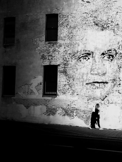 step out of the dark into your new bright life Streetart People And Art Faces Of EyeEm Face Paint Modern Art Street Art/Graffiti Contrast Lights And Shadows Australia Black & White Streetphoto_bw Street Photography EyeEm Selects Travel Photography Urbanphotography Urban Art A New Beginning Pixelated Silhouette Window Architecture Building Exterior Built Structure Focus On Shadow Graffiti Street Art Art Wall - Building Feature Walking Shadow EyeEmNewHere