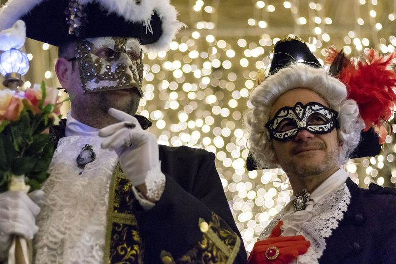 Close-Up Of Men Wearing Mask At Party