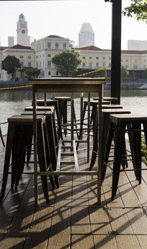Bar Stools In A Row Drinking By The River Water City Chair Table Architecture Building Exterior Sky Built Structure
