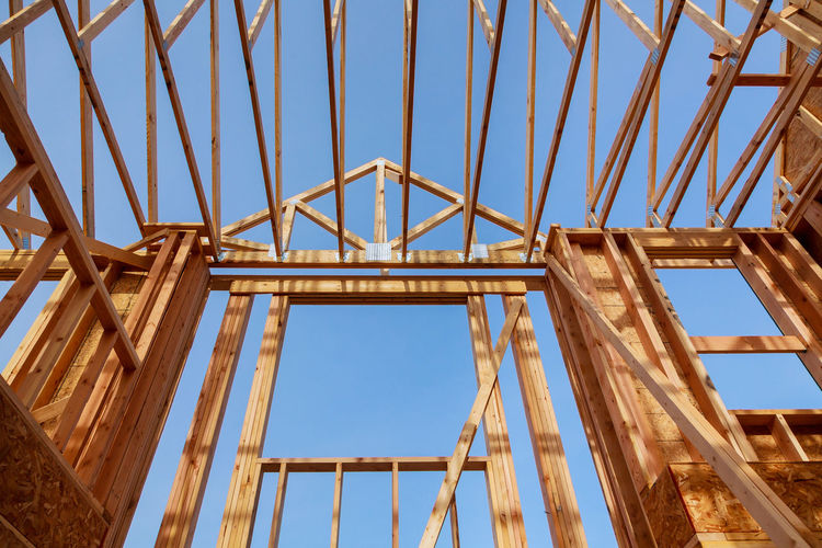 wooden roof construction, for home, home construction new building under construction Construction Construction Equipment Framing Home Industrial Renovation Roof Under Unfinished Work... Architecture Beams Build Building Built Structure Dwelling Frame Framework House House Construction Housing Lumber Plywood Reconstruction Residence Residential Building