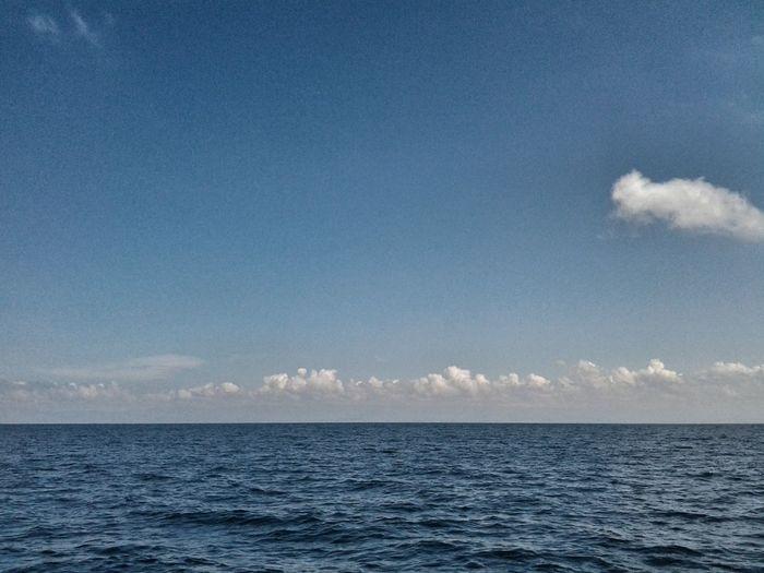 Blue sky over a calm sea