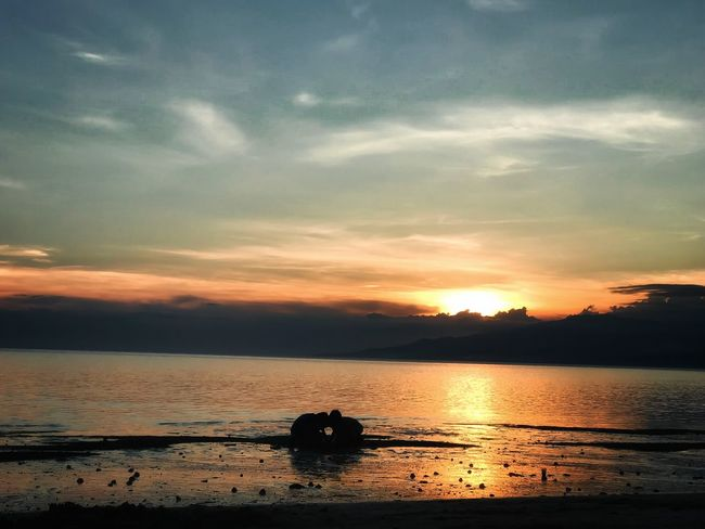sarbay Playful Innocence EyeEmNewHere Sunset IPhoneography Nature Horizon Over Water Orange Color Beach Tranquil Scene