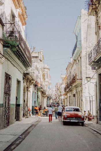 Been There. Cars Cuba Havana Taking Photos Architecture Building Exterior Built Structure Car City Clear Sky Day Full Length Land Vehicle Outdoors Real People Road Sky Street Streetphotography The Way Forward Transportation Travel Destinations Vintage Cars Women