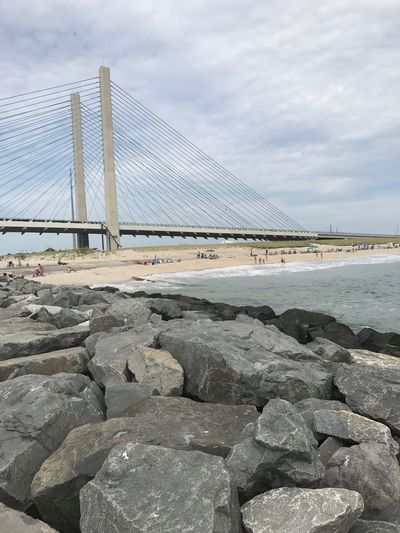 Beach Maryland Sky Architecture Cloud - Sky Connection Bridge - Man Made Structure Sea Built Structure Water Rock - Object Suspension Bridge Day Outdoors Transportation Sand No People Nature Building Exterior
