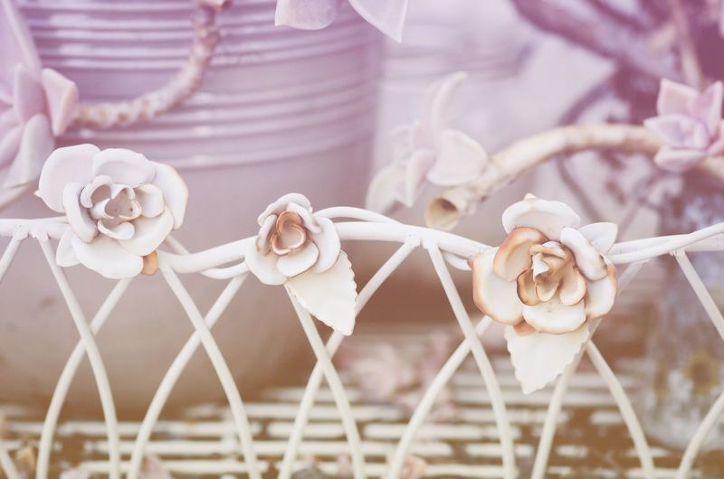 Artificial metallic roses on fence