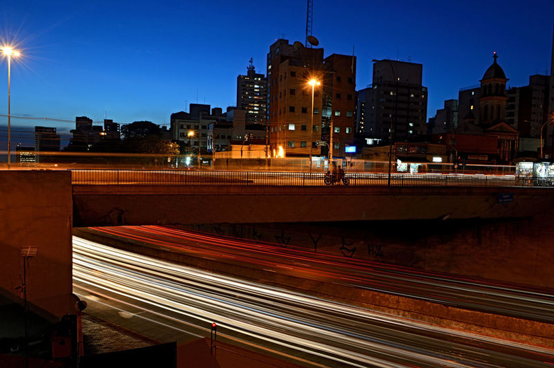 Architecture Building Exterior Built Structure City Clear Sky High Street Illuminated Light Trail Long Exposure Motion Night No People Outdoors Sky Speed Street Light Transportation Urban Scene