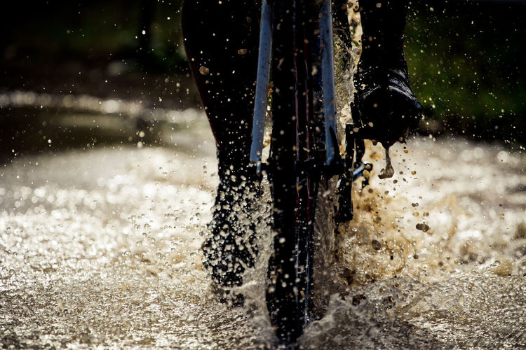 Cropped image of person cycling in water