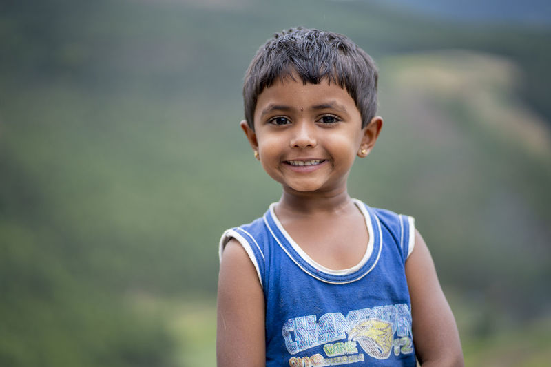 Portrait of smiling boy standing outdoors