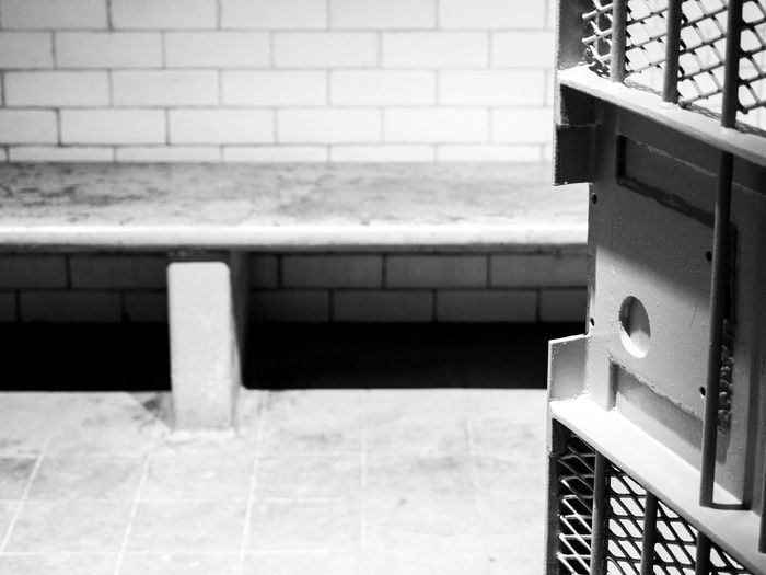 Holding cell in the former Supreme court of Singapore, people would be held here temporarily before trial 2 Architectural Feature Architecture Black And White Blackandwhite Building Court Courthouse Geometric Shape Indoors  Jail Jail Cell Lock Up Monochrome Repetition Tile Tiles Trouble