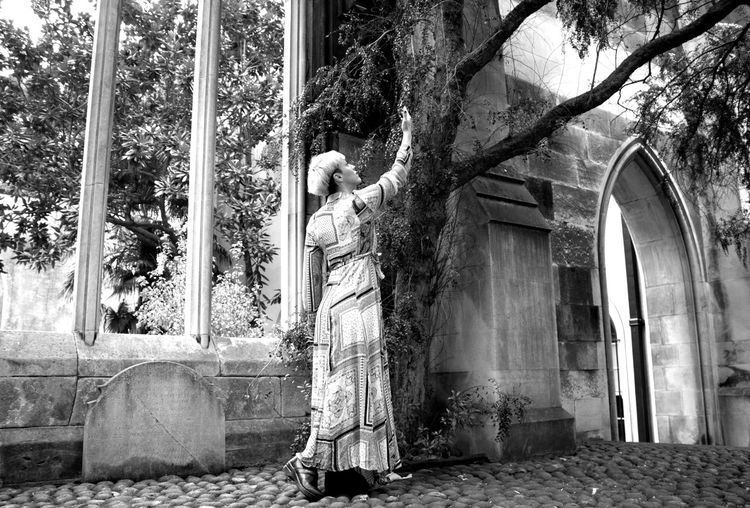 Statue amidst trees and building