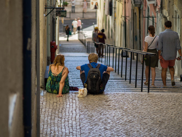 Portugal Tourist Adult Cat Day Lisbon People Real People Sitting On Steps Taking Break