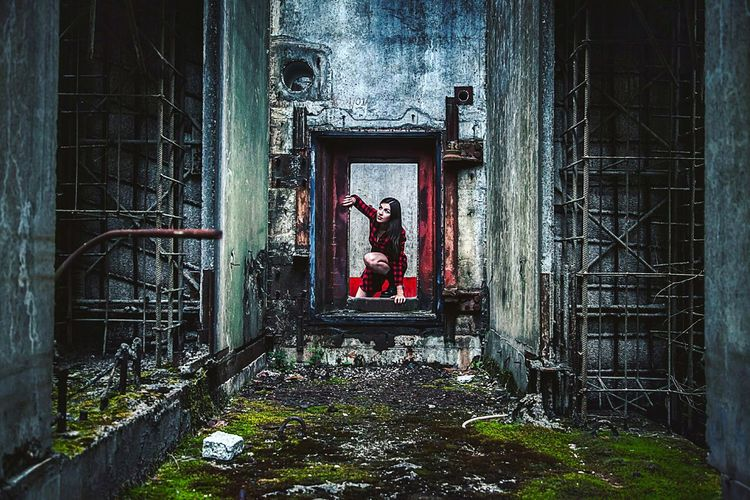 Full length of woman in red dress at nuclear power station