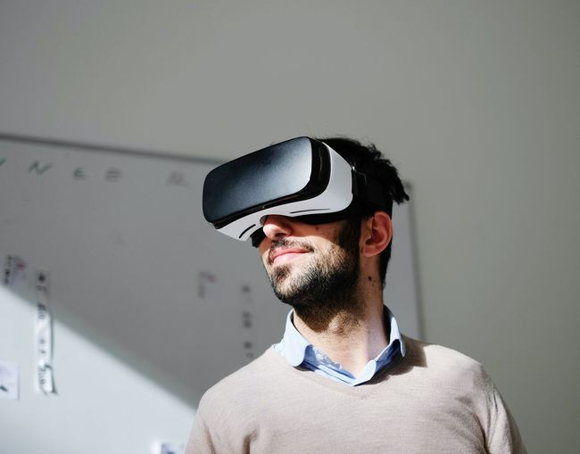 Portrait of man wearing virtual reality glasses