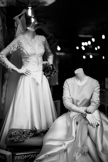 Mannequins wearing dresses seen from window display