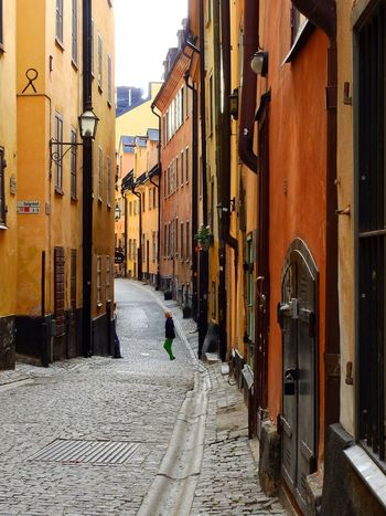 Cobblestone Streets Old Buildings Old Town Narrow Alley Walking The Streets Man Architecture Building Exterior City Narrow City Life Gamla Stan Stockholm Sweden