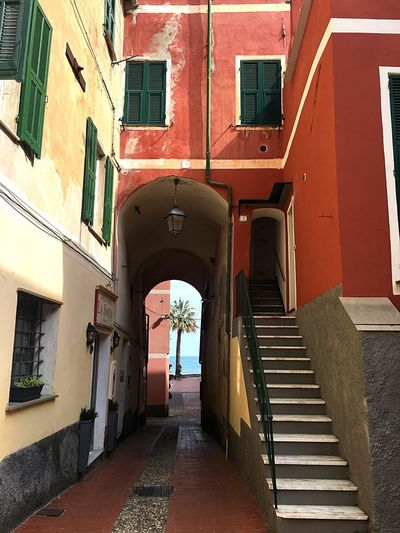 Laigueglia Shutter Yellow Italian Lantern Sea Old Town Travel Sunlight Summer Scenery Scenics Historic Historical Building Palm Tree Colorful Italy Laigueglia Old Stairs Red Architecture Built Structure No People Day Building Exterior Indoors  EyeEmNewHere
