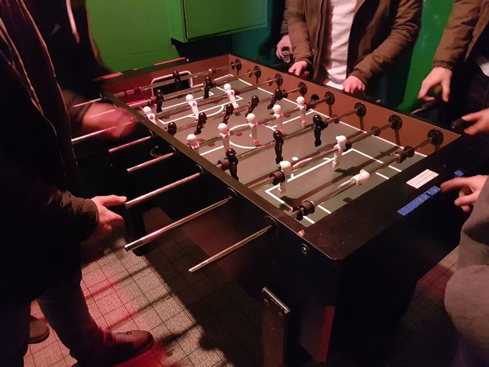 High angle view of men playing foosball