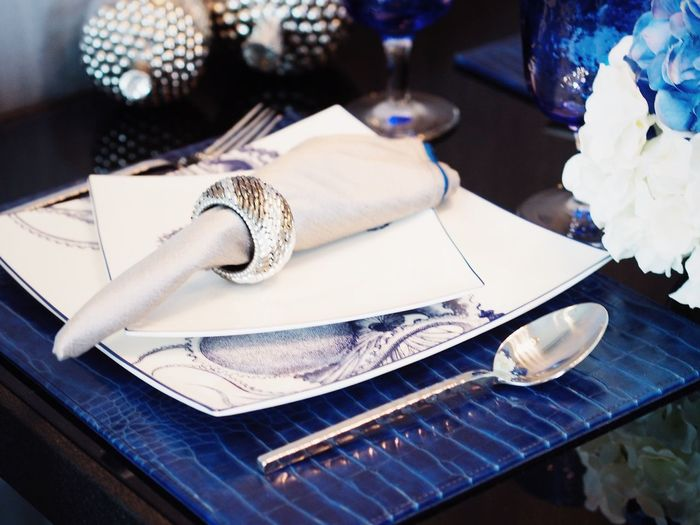 Close-up of place setting on table in restaurant