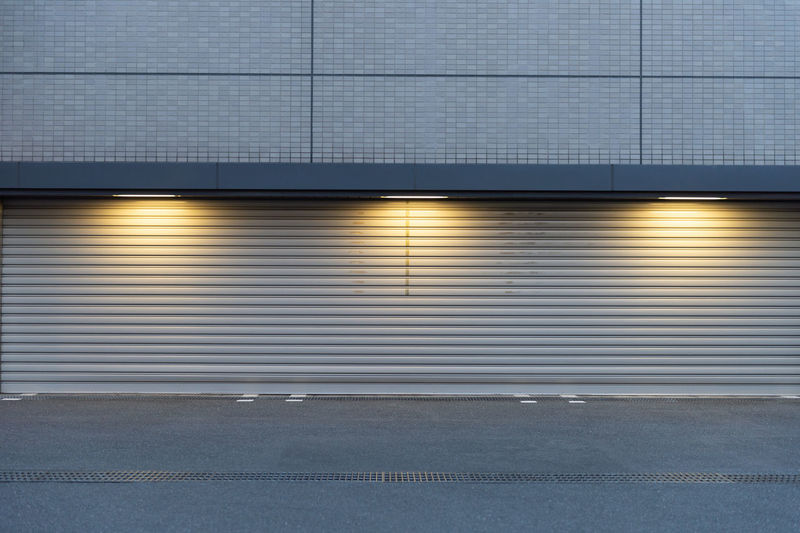 Architecture Metal City Built Structure No People Transportation Building Exterior Gray Corrugated Iron Blue Outdoors Building Road Iron Shutter Street Backgrounds Pattern Industry Day Corrugated Garage Silver Colored