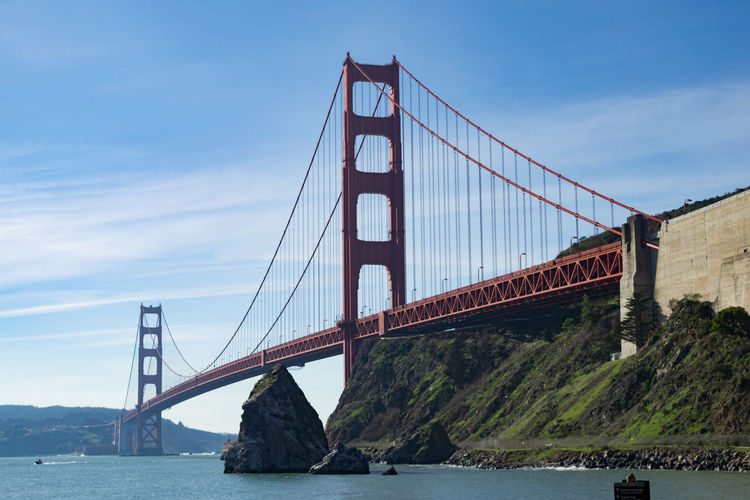 Low angle view of golden gate bridge over sea against sky