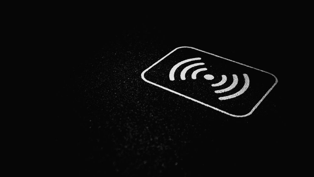 wireless charging pad close up Accessory Peripheral Adaptor Pad Electricity  Power Current Quick Charge Electro Magnet Symbol Magnet Android Smartphone Phone Qi Charging Charger Wireless Extreme Close Up Selective Focus Close-up Electricity  Close-up Communication Selective Focus