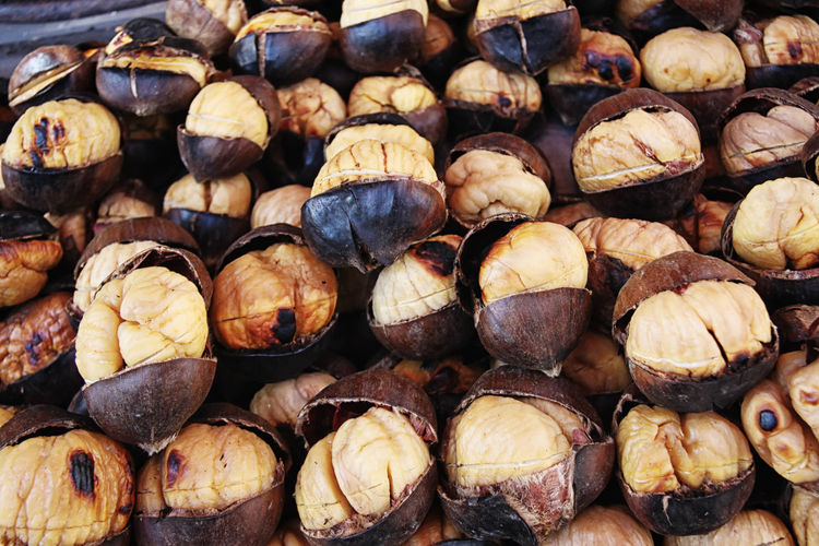 Close-Up Of Roasted Chestnut At Market
