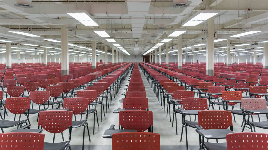 Absence Auditorium Chair Day Empty Illuminated In A Row Indoors  Large Group Of Objects Lecture Hall No People Red Seat Seminar