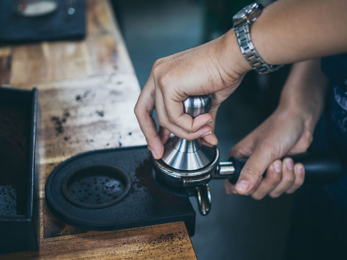 Cropped Hands Of Barista Preparing Coffee