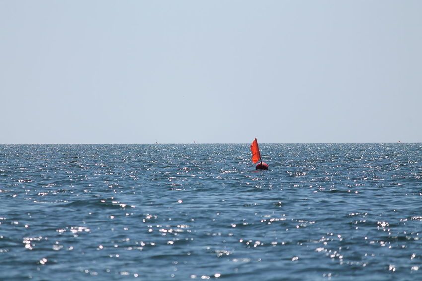 Sea Horizon Over Water Red Outdoors Sky Clear Sky Tranquil Scene Vacations Summer Buoy Tranquility Day Blue Water Nature Scenics Red Buoy Marker