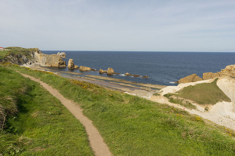 Cantabria Architecture Arnia Beach Beauty In Nature Cliff Coast Day Grass Holiday Horizon Over Water Landscape Nature No People Ocean Outdoors Scenics Sea Sky Tranquil Scene Tranquility Water