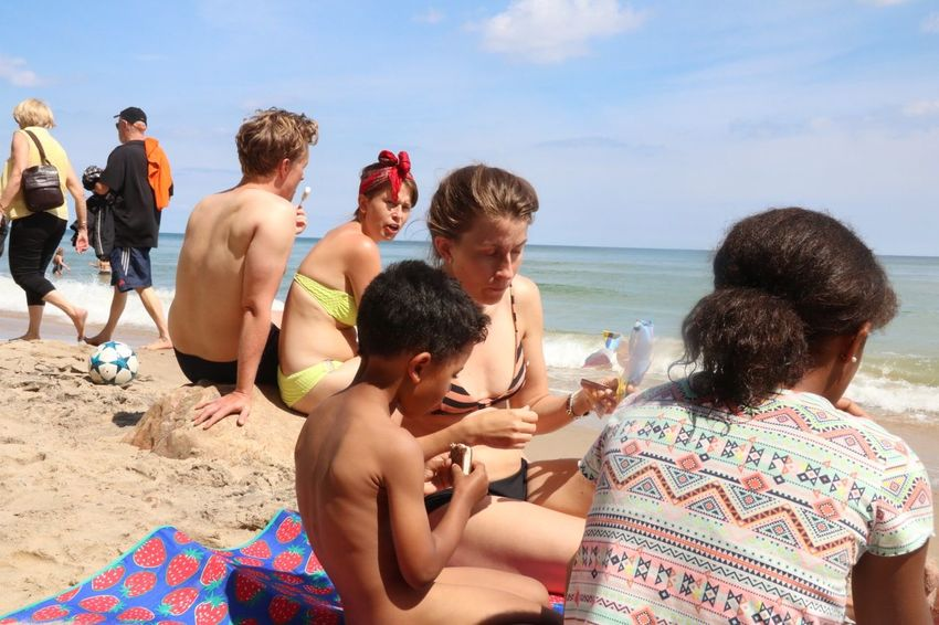Summertime with the fam Beach Land Water Leisure Activity Group Of People Trip Human Connection Real People Women Bikini Swimwear Vacations Holiday Men Sea Shirtless Outdoors Summer Sky Adult