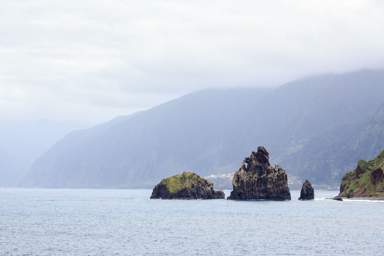 Madeira Island Mountain Water Beauty In Nature Sky Scenics - Nature Tranquil Scene Tranquility Sea Rock Waterfront Nature Day Cloud - Sky Non-urban Scene Mountain Range Rock - Object Solid Idyllic Outdoors No People Stack Rock